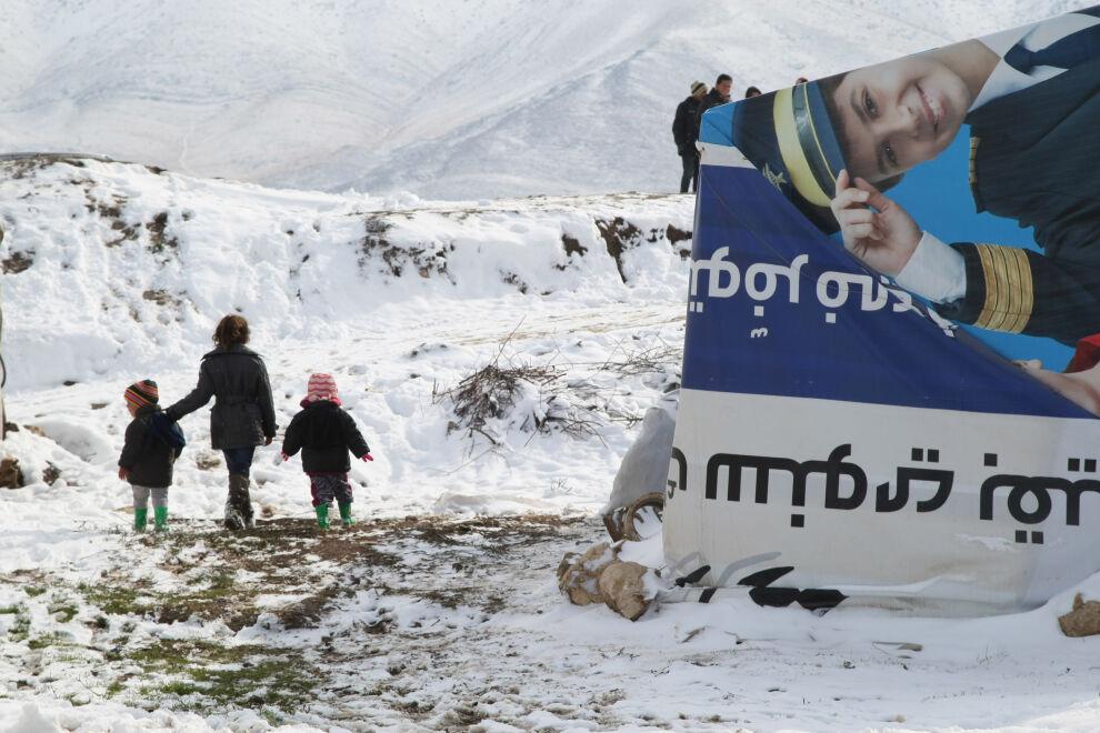 Syyrialaisia pakolaislapsia Libanonissa talvella 2013, jolloin talvimyrsky toi alueelle runsaasti lunta ja pakkasta. © UNICEF/UNI155405/Dar Al Mussawir