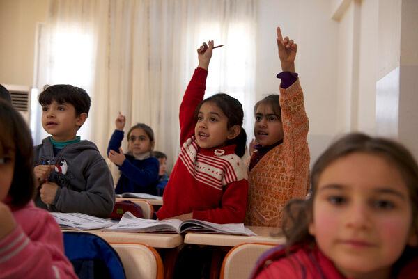 Syyrialaispakolaisia UNICEFin tukemassa esiopetuksessa Turkissa. ©UNICEF/NYHQ2014-0190/Noorani